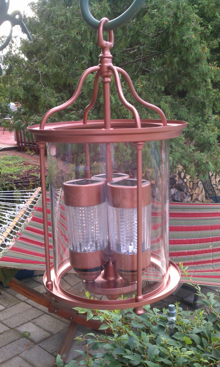I found this old hanging chandelier at the Habitat Restore. A little bit of cleaning and taking the old parts off, some spray paint and some solar lights turned it into a beautiful outdoor hanging light to put in front of the roses on the upper patio!! I just love upcycling old things and finding a new use for them.