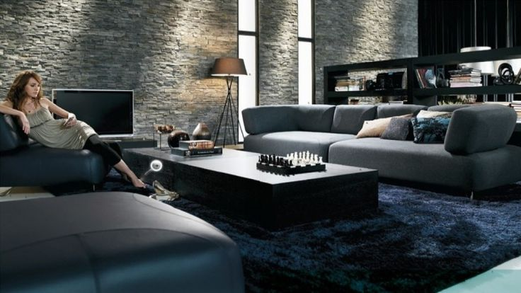 Astonishing Living Room Interior With Elegant Dark Stone Wall And Large Sectional Sofa Set