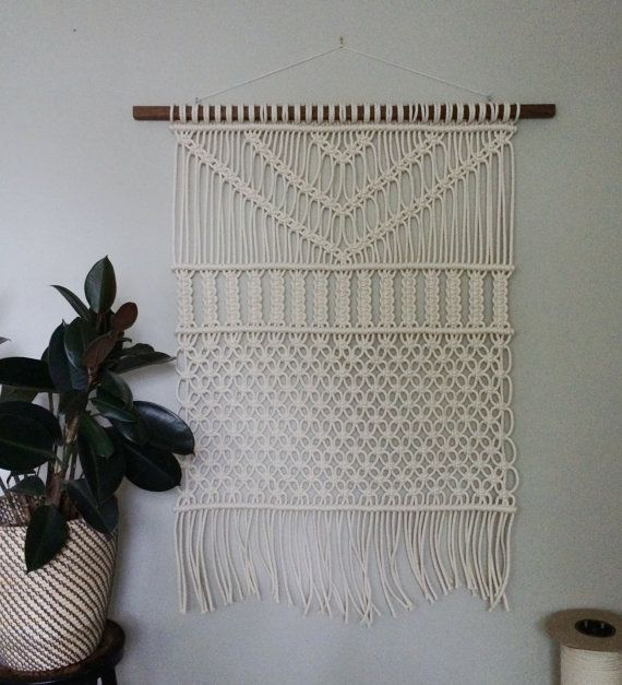 DESCRIPTION <<  Handmade macrame wall hanging. Dowel is a 1x2 walnut hardwood that I sanded and oiled. Rope is 1/4 braided cotton. This wall