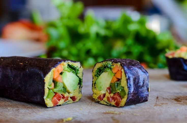 "Vegan Nori Rolls     INGREDIENTS:  nori sheets   thinly slice the following vegetables:   sweet red pepper   green bell pepper   carrots   lettuce leaves   1 avocado   parsley  hummus     Spread hummus on nori sheets, pile the vegetables on, roll up tightly and slice into 1-2"" slices."