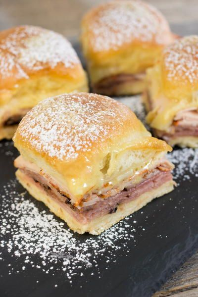 These delicious brunch sliders take the essence of that Monte Cristo sandwich you know and love and transforms it into an easy brunchable dish that will please a crowd. This is the perfect thing to add to your brunch menu no matter the occasion. Melty, gooey Gruyère cheese, turkey, ham and some Dijon mustard are placed on a King's Hawaiian sweet roll and then topped off with a sprinkling of powdered sugar for a dish that will not soon be forgotten next time you gather together for a speci...