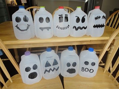 Ghost milk jugs (cute) ... you could also fill them up with shredded orange paper