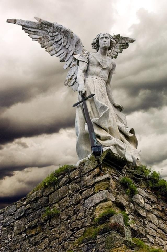 archangel protecting cemetary in cantabria, spain