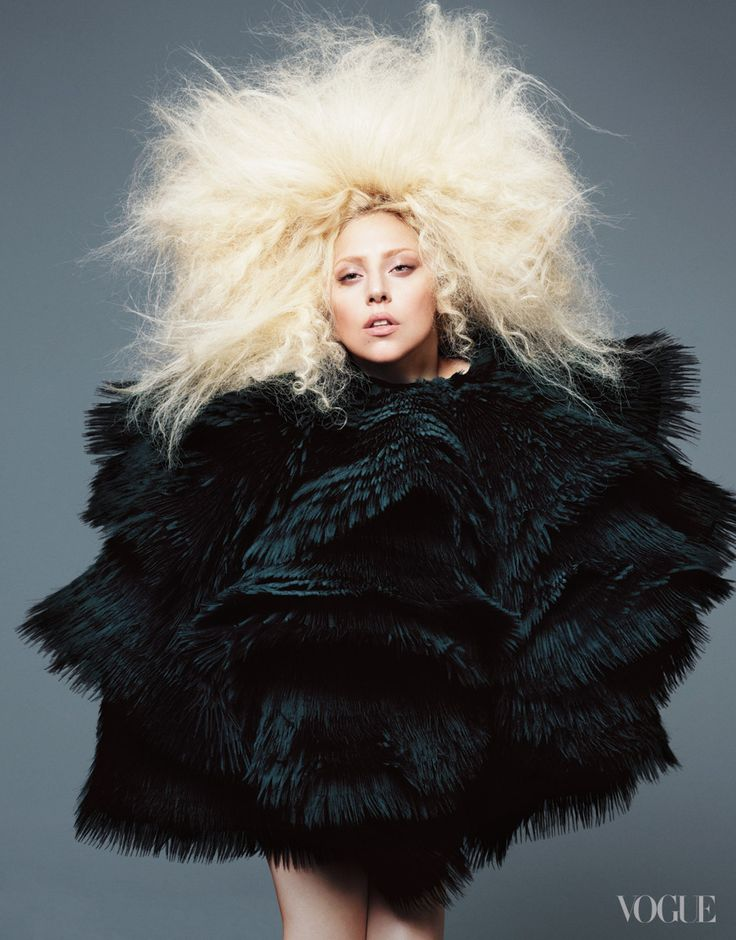 The pop star poses in Alexander McQueen.   I would so LOVE to get a few Alexander McQueen suits and some shoes too.