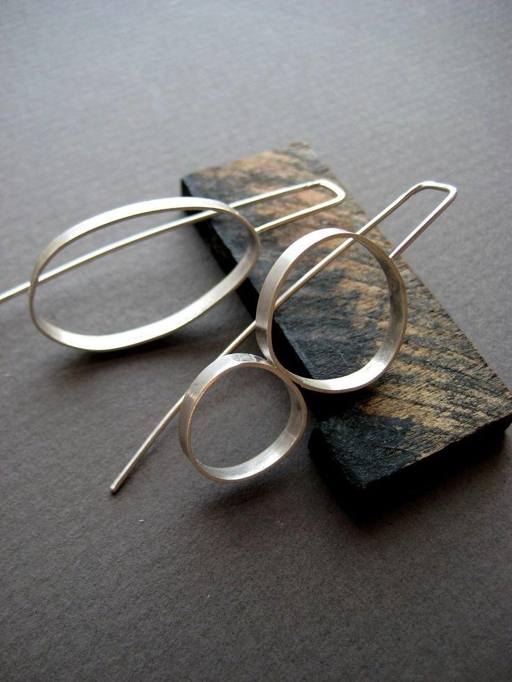 This is soooo RACHEL!!  mismatched earrings