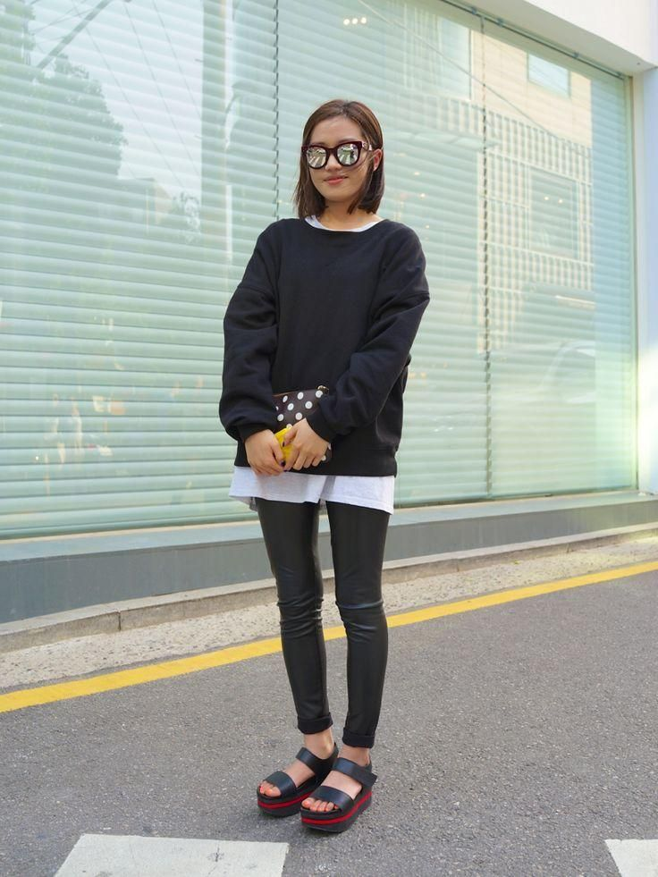 20 Ways to Pull Off Platforms This Spring - black sweatshirt layered over a white tee, styled with leather pants, a polka dot clutch, mirrored sunglasses, and chunky platform sandals