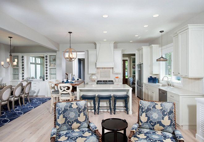 An impressive kitchen painted in Benjamin Moore's Revere Pewter (walls and cabinets), and with stunning Ann Sacks tile backsplash, quartz countertops, richly stained bistro table and Viking appliances overlook the generous, but clearly defined, living and dining rooms. Benjamin Moore's Revere Pewter Kitchen. Kitchen painted in Benjamin Moore's Revere Pewter. Benjamin Moore's Revere Pewter. Benjamin Moore's Revere Pewter. #Kitchen #BenjaminMooresReverePewter