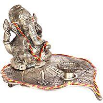 Oxidised peepal leaf diya embossed ganesh ji #diwalipoojathali #Primogiftsindia @ www.primogiftsindia.com/diwali/diwali-pooja-thalis-233.html