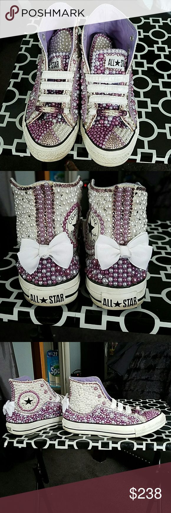 Custom Made Hi Lo Converse YES!! I made these...i love a junk shoe so i took a double hi/lo converse shoe and created this gem.. made with genuine swarovski crystals and pearls in purple and white.. both shoes ate fully decorated.. if u love attention these are for you..i took away the regular tie shoestrings and replaced them with elastic so the shoe can be pulled on to show the full effect of the shoe..size 5 in men's 7 in women's.. price is very firm Converse Shoes Sneakers