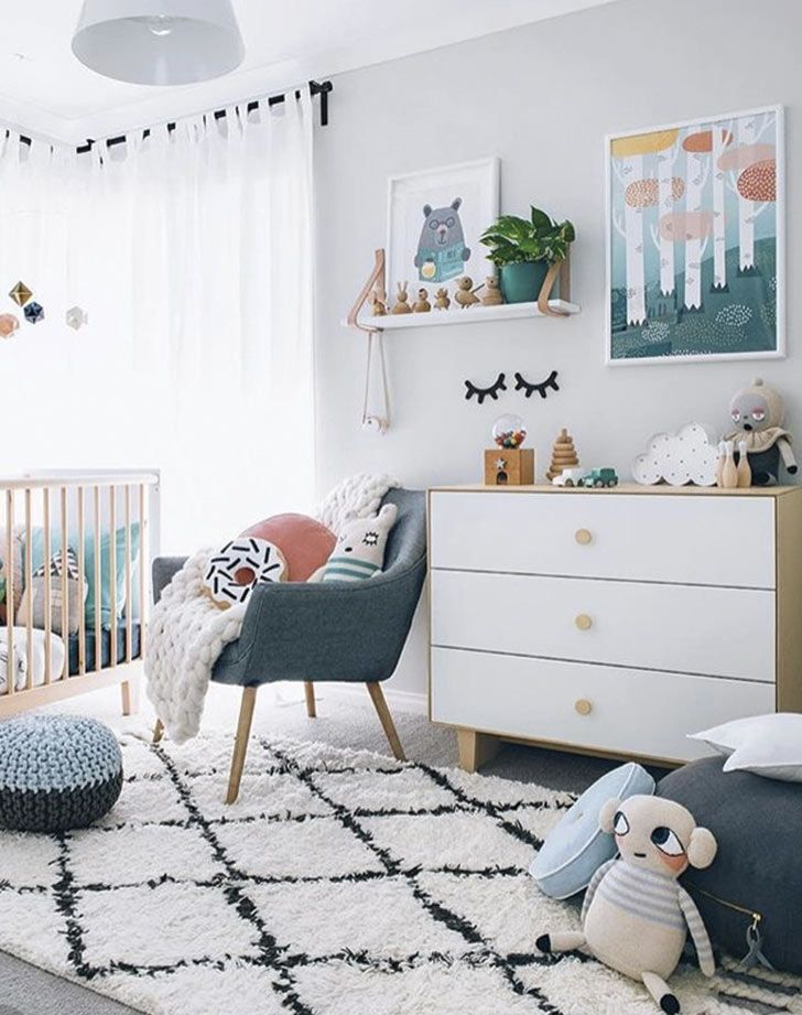 Gender neutral nursery ideas we love: Teal and blonde wood. The perfect complements to your baby's new room.