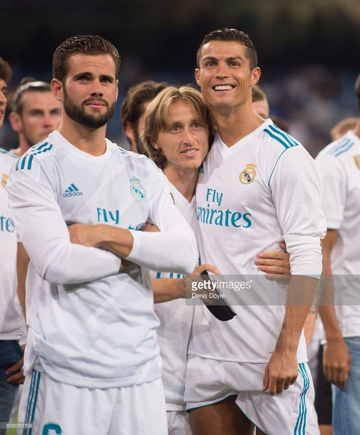 Cristiano Ronaldo, Luka Modric and Nacho of Real Madrid CF celebrate after Real beat ACF Fiorentina 2-1 to win the Santiago Bernabeu Trophy match between Real Madrid CF and ACF Fiorentina at Estadio Santiago Bernabeu on August 23, 2017 in Madrid, Spain.