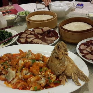Peking Duck and fried fish in sweet and sour sauce