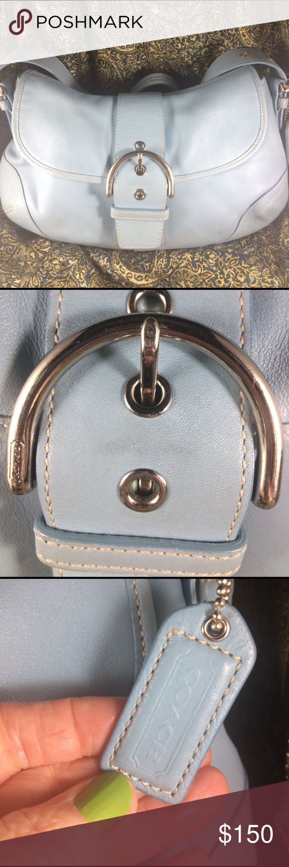 Cute Authentic Coach soho pool leather buckle bag This is an adorable authentic Coach light blue shoulder bag with silver hardware. Cute kidney shape with a large buckle in front. Sip compartment in side and two other open pockets. Signature fabric on inside of bag. This bag is gently used with a few small scuff marks and one small ink mark on outside. On the inside seems to have some sort of tape residue along seem which is pictured I will attempt to remove this residue before mailing off…