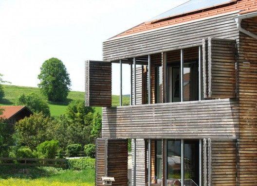 House K / becker architekten:  Operable slatted wood facade.