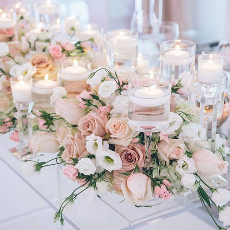 How romantic are these centrepieces with the flowers and candles?   How will you decorate your tables?