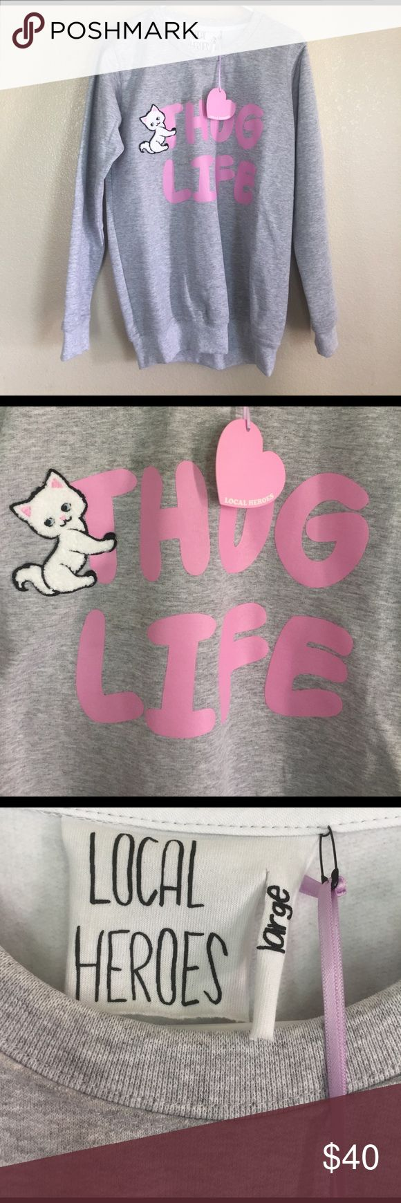 NWT Thug Life Cat Sweater In love with this Local Heroes cat sweater I bought from Dollskill but it runs like a medium :( Will fit a juniors size Large if you like your sweaters fitted and not oversized. This size is sold out online. Price is firm! EUC- not UNIF UNIF Sweaters