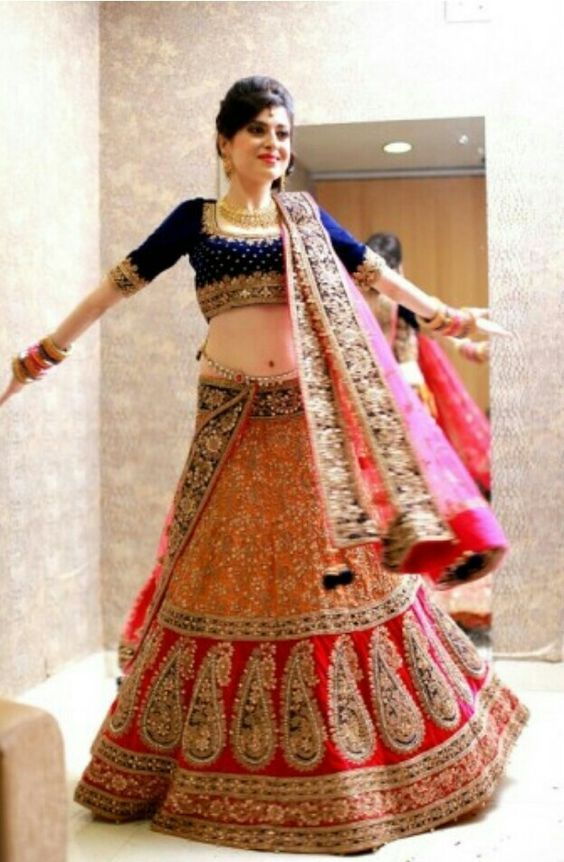 Bridal lehenga. The blouse is awesome. Everyone should definitely have a bloue like this. Indian bride