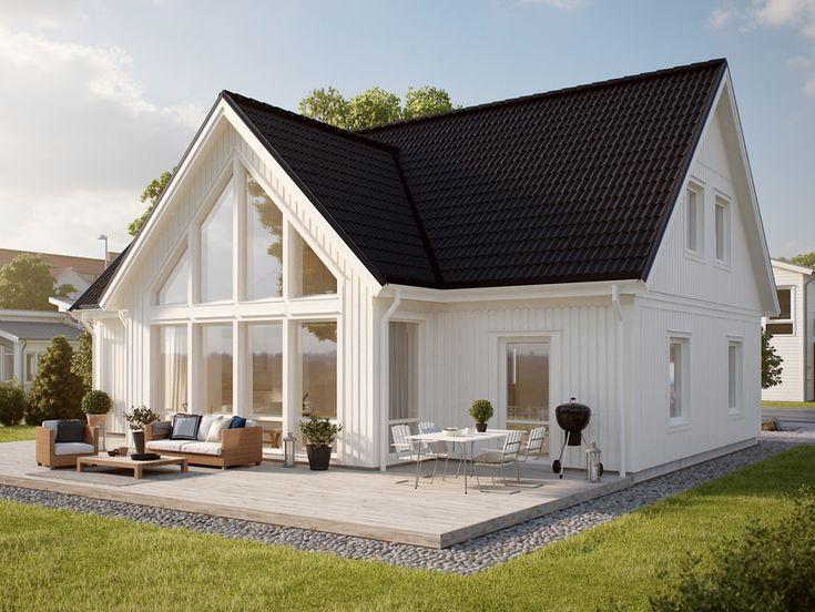 Mycket fönster och ljusinläpp för huset Kärgården. Ett 1,5-planshus från hustillverkare Myresjöhus.