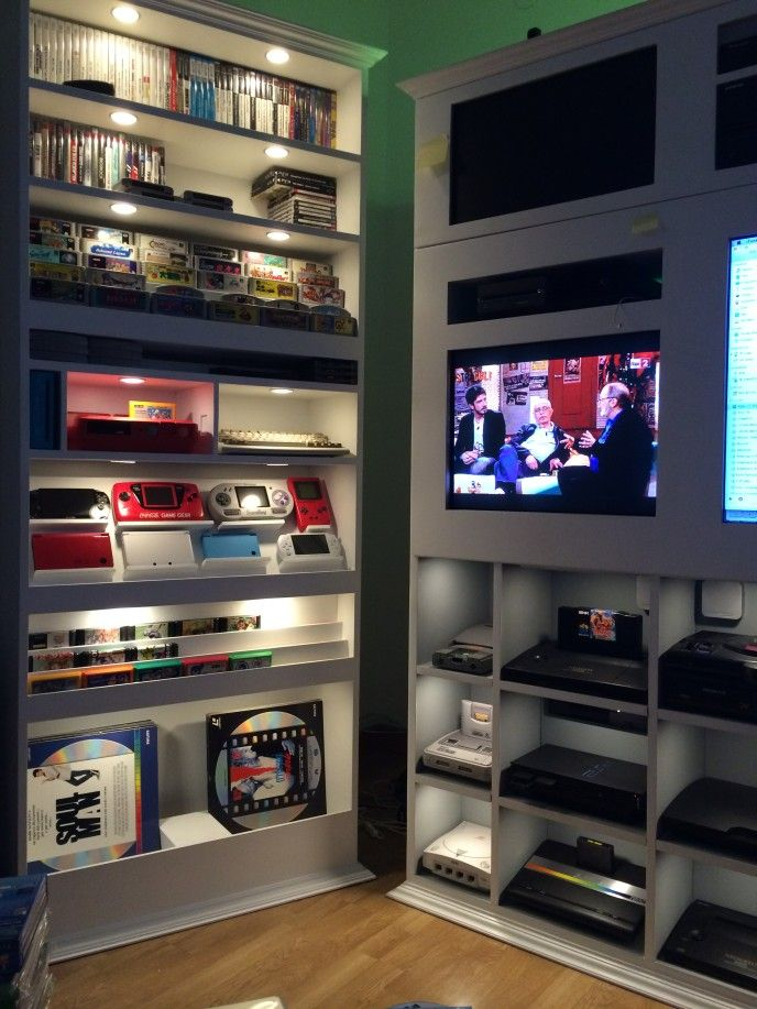 Hand-made custom video game shelves via Racketboy user wheeezy. Great inset lighting and display. Stylish gaming room.