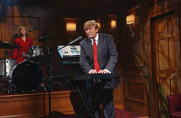 LIVE Episode 16 Air Date Pictured Amy Poehler as Carolyn Kepcher Donald Trump during 'The Apprentice Band' skit on April 3 2004
