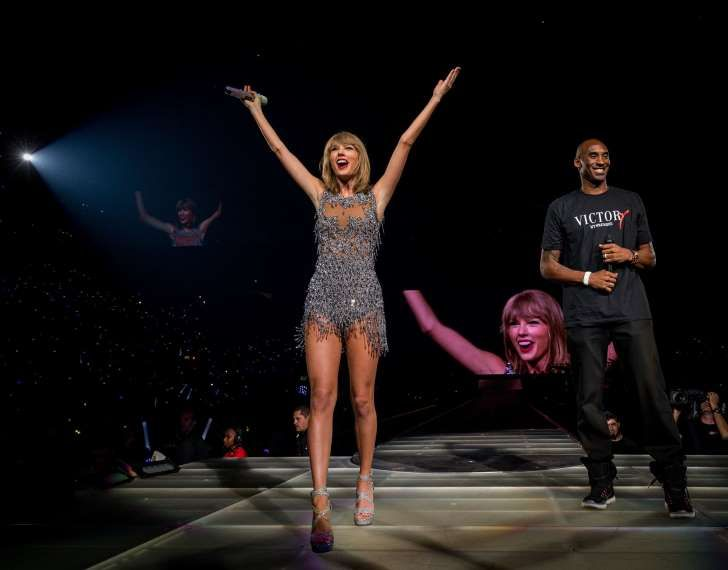 "Taylor Swift kicks off her L.A. & #39;1989 tour stop with Kobe Bryant, Ryan Tedder and more! During her now famous ""Style"" catwalk, Taylor brought down the house, introducing L.A. Lakers star Kobe Bryant, ""Me being up here means I am the coolest dad to my kids,"" Bryant said onstage."