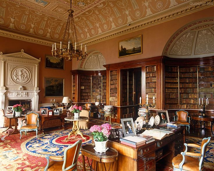 The Library, known in the 18th century as the Saloon, is dominated by Sir Charles Barry's Victorian mahogany bookcases. The ceiling and overmantel are by Robert Adam