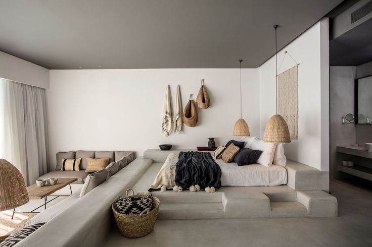 talk about neutrals done right. this boho modern beach bedroom has texture galore and i love that sunken living room.