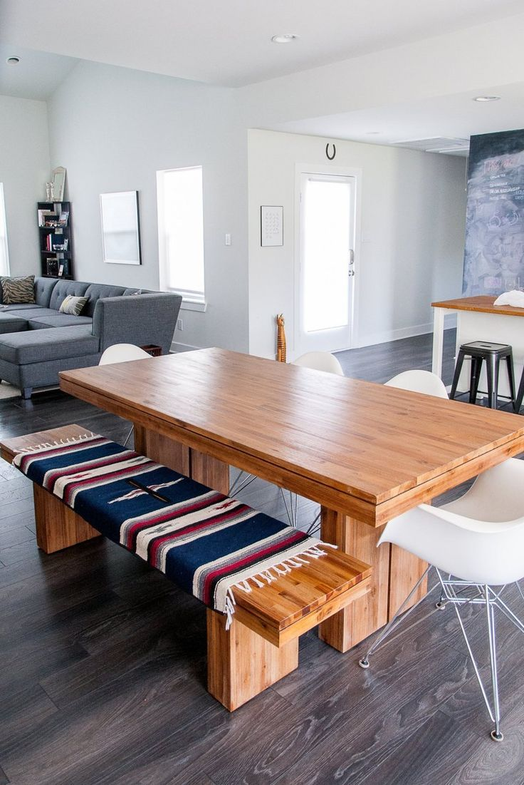 House Tour: A Modern, Minimal Marfa-Inspired Apartment | Apartment Therapy - love this table/bench and the way they covered the bench with southwestern fabric