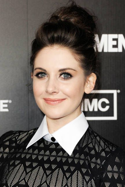 ALISON BRIE  Instead of doing a traditional ballerina bun, go for volume; height at the crown and a bigger, slightly mussed bun is fun-loving and flattering.