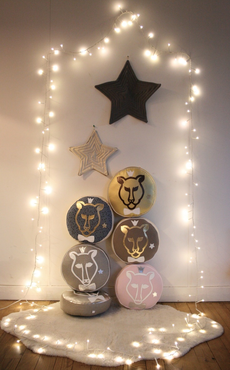 twinkle lights make all the difference! Fabric stars and animal pillows. Crowned animals wearing bowties, exactly.