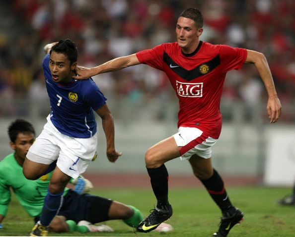 Federico Macheda of Manchester United (R) holds off Mohd Aidil Zafuan of Malaysia XI during the pre-season friendly match between Manchester United and Malaysia XI at Bukit Jalil National Stadium on July 20, 2009 in Kuala Lumpur, Malaysia.