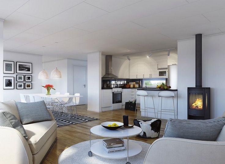 cuisine ouverte sur salon et salle à manger en noir et blanc avec poêle à bois