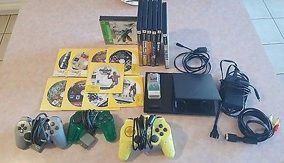 PS2 Slim back system, 3 controllers, 3 memory card and 16 games