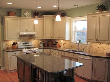 Nice Combo Of Recessed Lighting, Under Cabinet Lighting And Pendants. Also  High Ceilings With