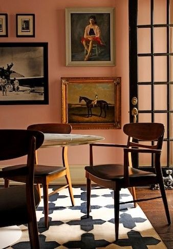 love the pink wall color, gallery wall, black door and Madeleine Weinrib black/white rug