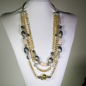 Multilayer gold-plated chain necklace accompanied by semi precious grey pink stone with silver and gold plated pieces