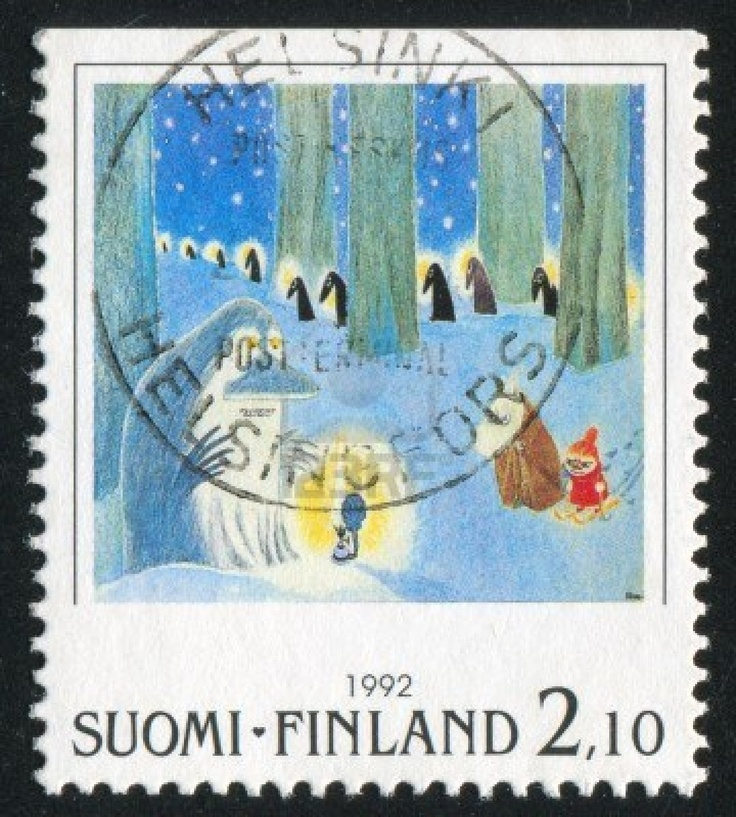 FINLAND - CIRCA 1992: stamp printed by Finland, shows Moomin characters in winter forest, circa 1992 Stock Photo