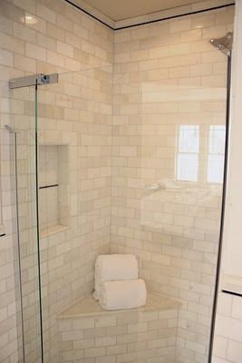 """example of little corner """"seat"""" solid tiled to the floor.  do not pay attention to the cubby, we want a ledge, not a cubby."""