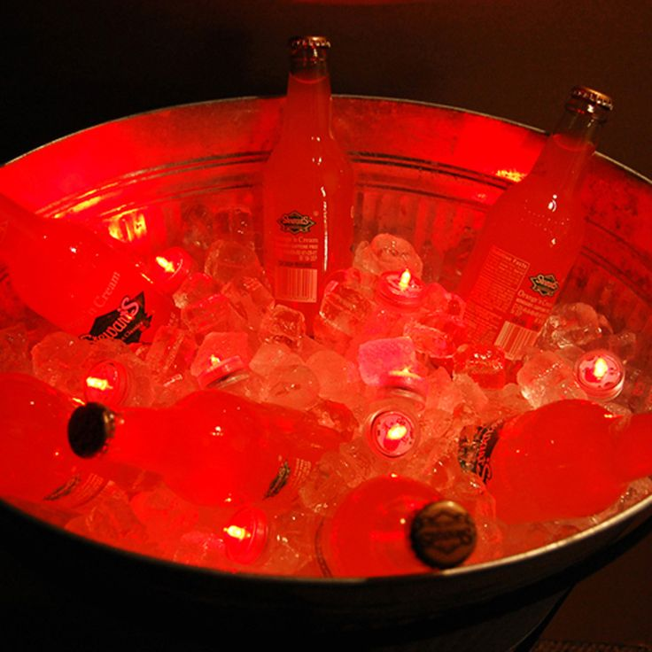 Add submersible RED LED lights to your ice bucket. Or try red, white and blue for a patriotic look! http://www.lumabase.com/categories/patriotic