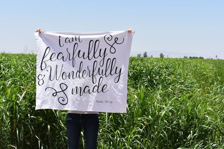 """This blanket features a Bible verse that perfectly describes your little one: """"I am fearfully and wonderfully made"""" Psalm 139:14.This handmade baby blanket was created for the purpose of keeping your baby wrapped up snug! It is the perfect size to grow with your baby, so that they can still use it as a blanket when they are in their crib or toddler bed. Both the security blanket and swaddle blanket sizes can be used as a tapestry at a baby shower or on a wall in your baby's nursery."""