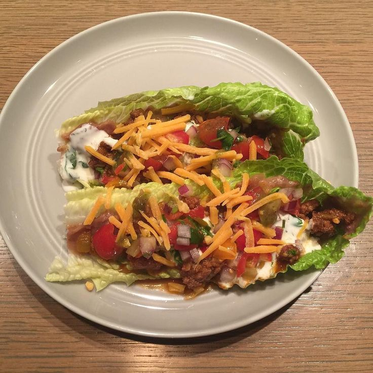 Dinner tonight is grass fed ground sirloin tacos in lettuce cups. I made a nice cream using nonfat Greek yogurt instead of my typical sour cream. So good and light on carbs because I had cereal for lunch haha Taco meat seasoned with my homemade enchilada sauce mix Mashed pinto beans with lots of cumin and garlic Homemade pico de gallo Greek yogurt crema w/ jalapeños and cilantro shredded cheddar Hot sauce (jalapeño & tomatillo #foodstagram #flexibledieting #iifym #cleaneating #cleaneat...