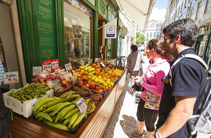 Food shopping at a Lisbon grocery on the Lisbon Delish bike tour