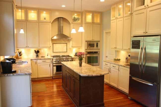 Cream cabinets dark island wood floors kitchen for Beautiful dark kitchens