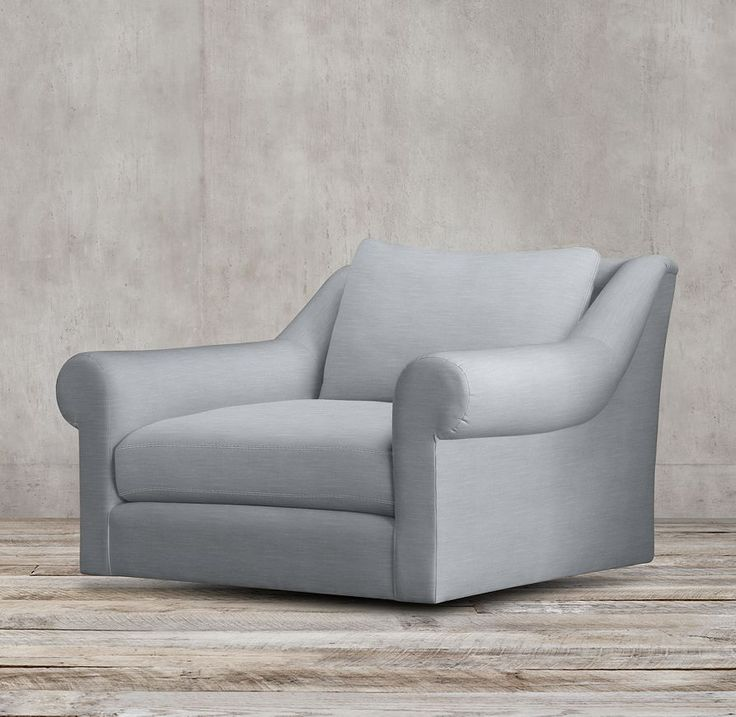A Shapely Swivel Seat Inspired By Mid Century Design Our: Belgian Roll Arm Upholstered Swivel Chair