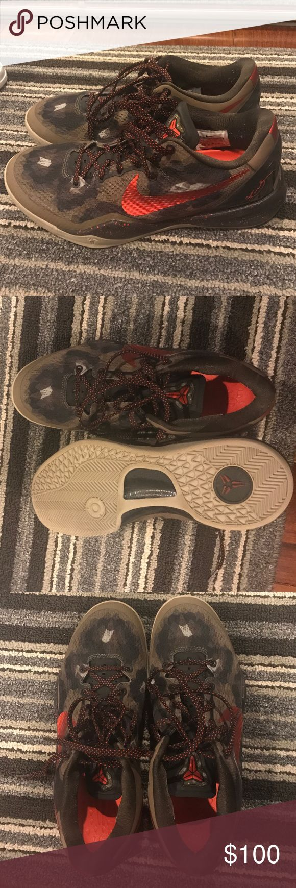Men's Kobe Bryant Camouflage basketball sneakers Men's Kobe Bryant red and camo basketball sneakers. Size 8.5. Worn a few times but like new, great condition! Nike Shoes Sneakers