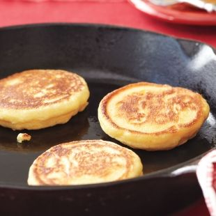 Thought to be the precursors to today's pancakes, johnnycakes (also called hoecakes) are made with cornmeal. They date back to the early 1700s, when frontiersmen cooked the unleavened batter over an open flame on the base of a metal hoe. Unlike the originals, these johnnycakes include eggs and baking powder, which help yield a puffy cake. Serve with maple syrup.