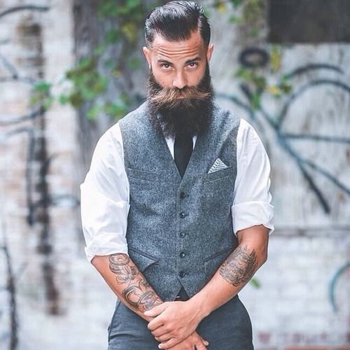 It's always an image like this that causes me to consider a tattoo or two....but the vest-i-ness works so well here!