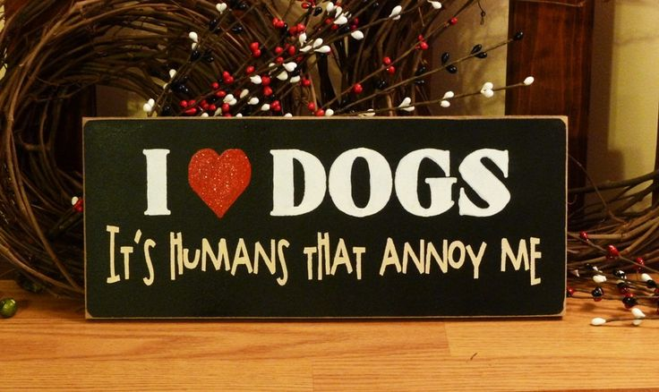 I Love Dogs It's Humans That Annoy Me Funny Painted Wood Pet Sign. $10.95, via Etsy.