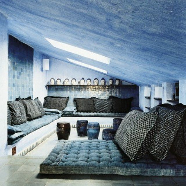 Love the feel of this blue room something about the sloped ceiling and the rich color feels very soothing