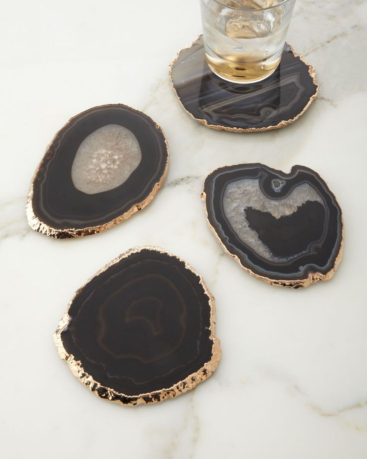 "Handcrafted coasters. Natural agate edged with 18-kt. gold plating. Size, shape, and color of stone will vary. Set of four; each, approximately 5""Dia. Imported."